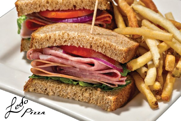 Photo of Italian sandwich on wheat bread with fries