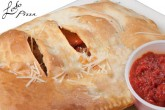 photo of chicken calzone with side of ledo sauce