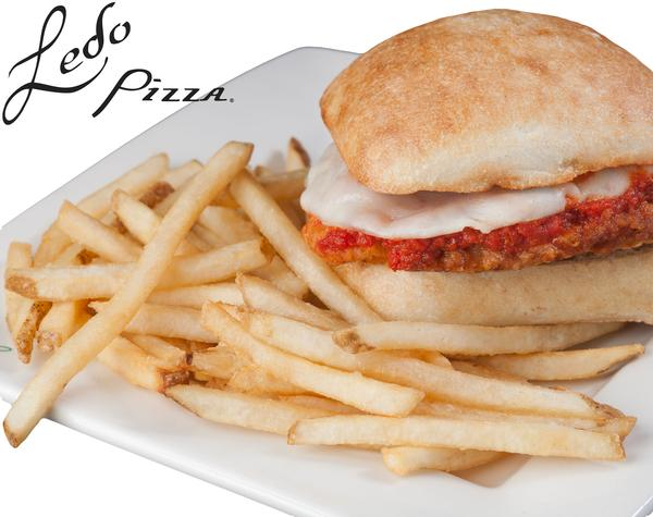 photo of chicken parm sandwich with fries