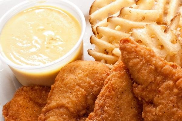 photo of chicken fingers with fries