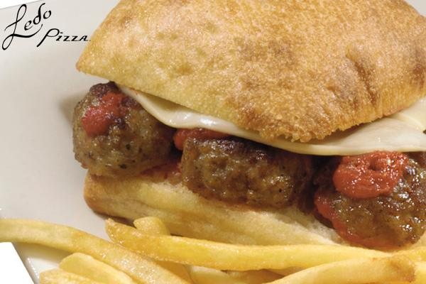 photo of meatball sandwich with fries