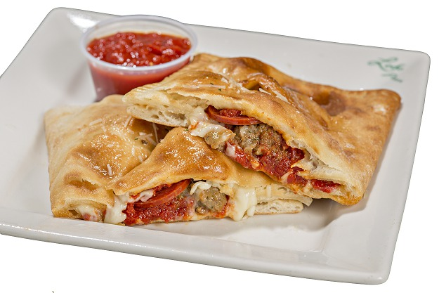 Photo of a cut meatlovers calzone