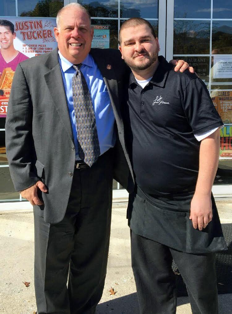 Governor Hogan embracing Ledo Pizza Employee